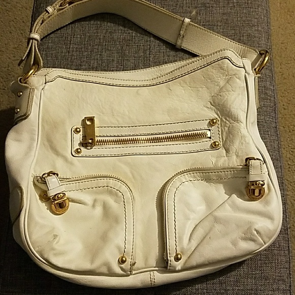 aec46f11cb7 Marc Jacobs white leather purse. M_5ab7ce5505f4302154b91fd2